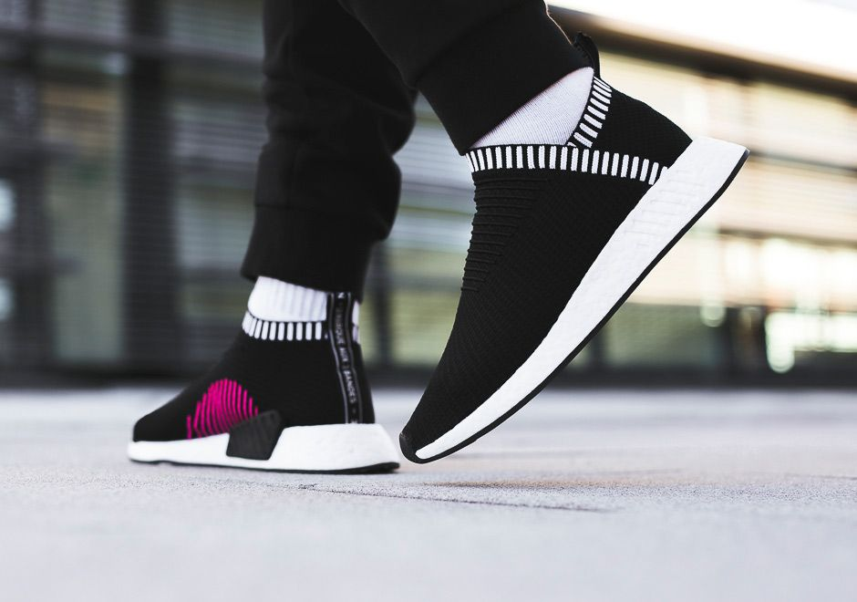 c3e63e38397 The adidas NMD City Sock 2 will release in a Core Black (Style Code  BA7188)  colorway this Spring 2017 season with pink medial stripes. Details here