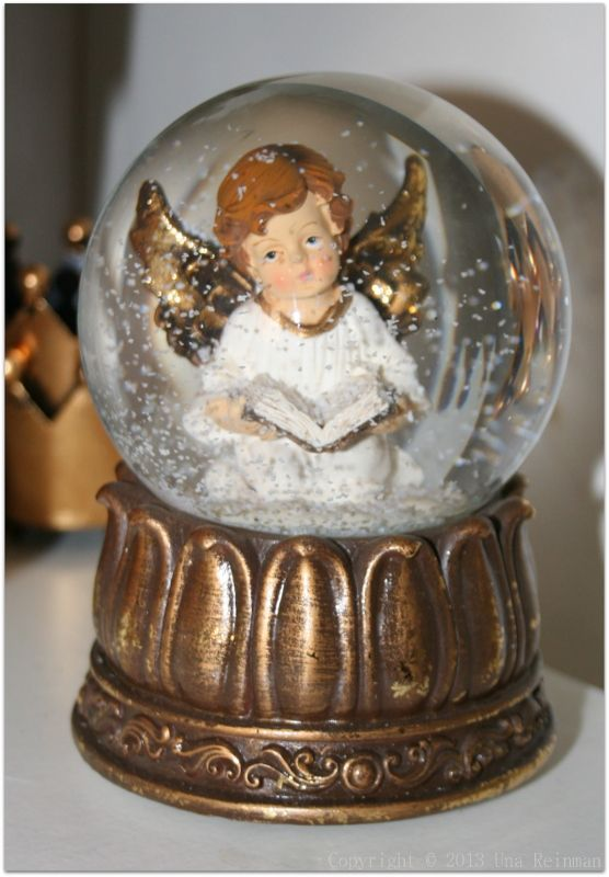 Tall angel Christmas snow globe
