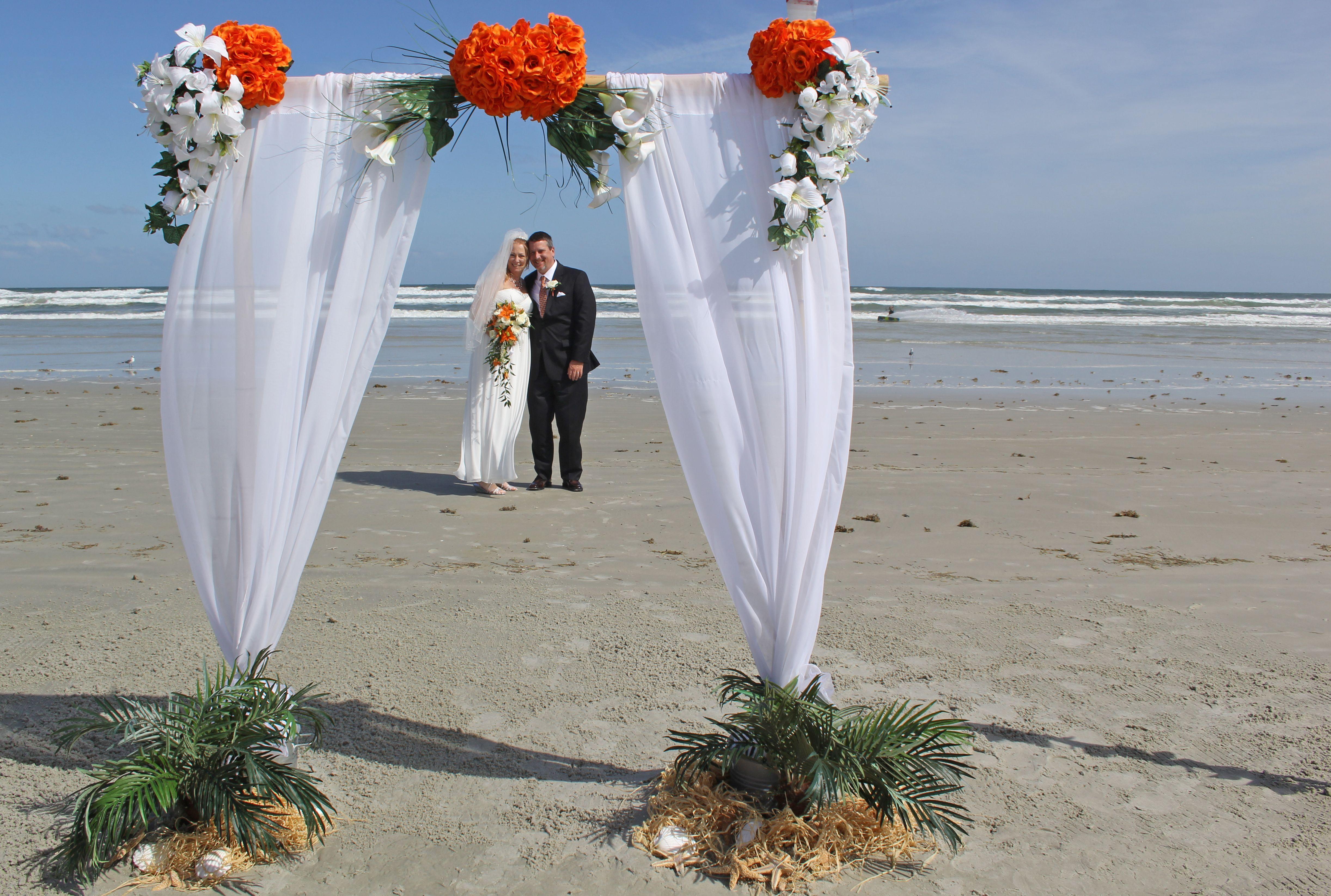 Sara Two Post Bamboo Arch In White Orange As Beach Wedding New Smyrna