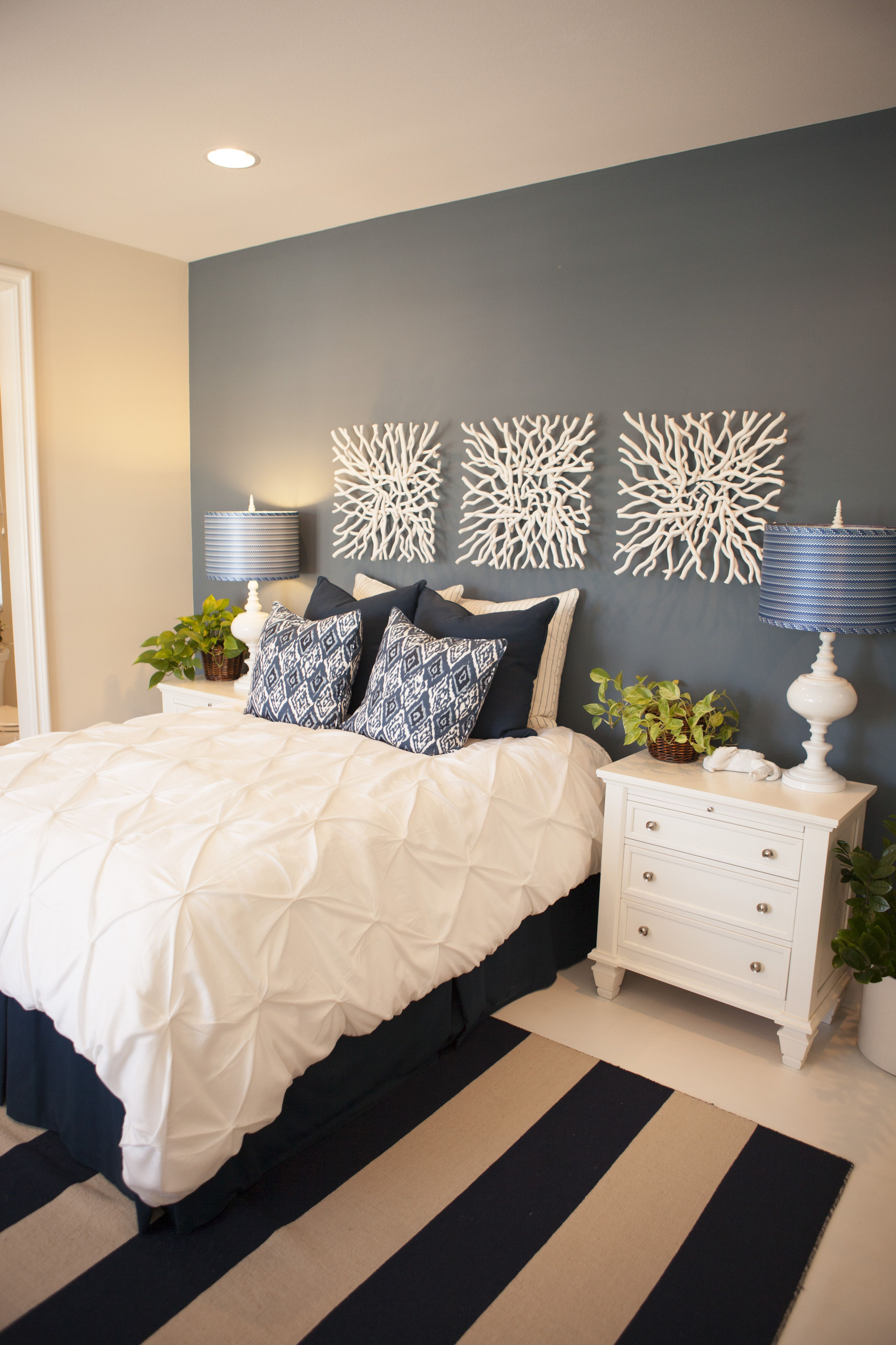 Guest Bedroom Navy Walls Striped Rug White Bedding
