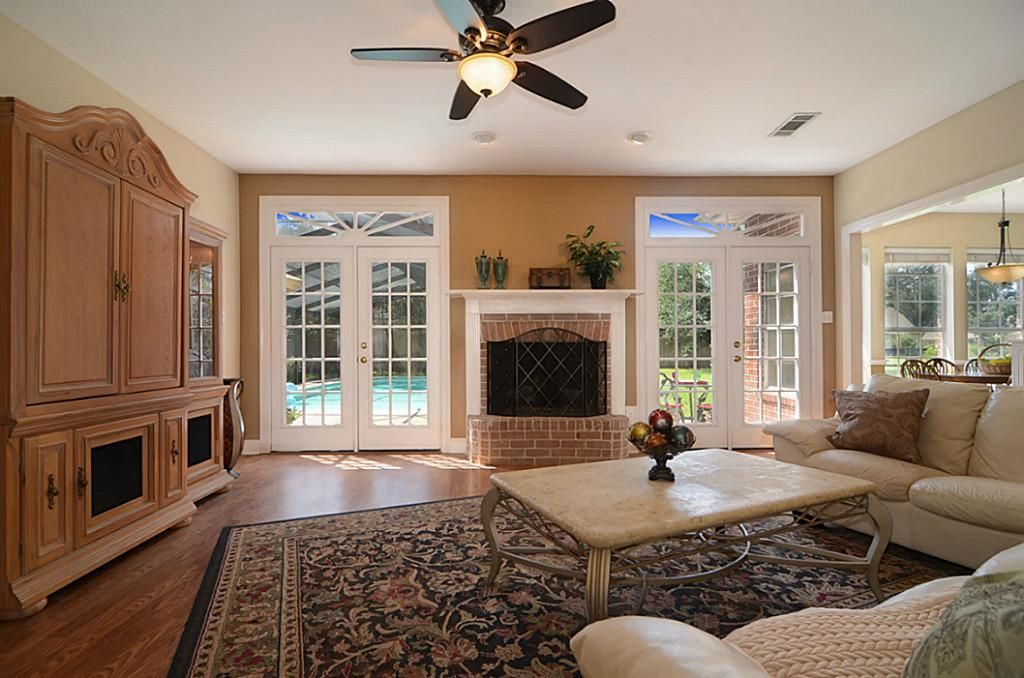 Living Room French Doors With Fireplace Between Teal Living