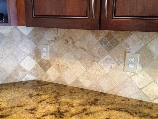 Backsplash Installation In Tampa Florida Westchase 4x4 Medium River Tumbled Travertine Set Diagonal With A 2x2 Noce Backsplash Westchase Tile Installation