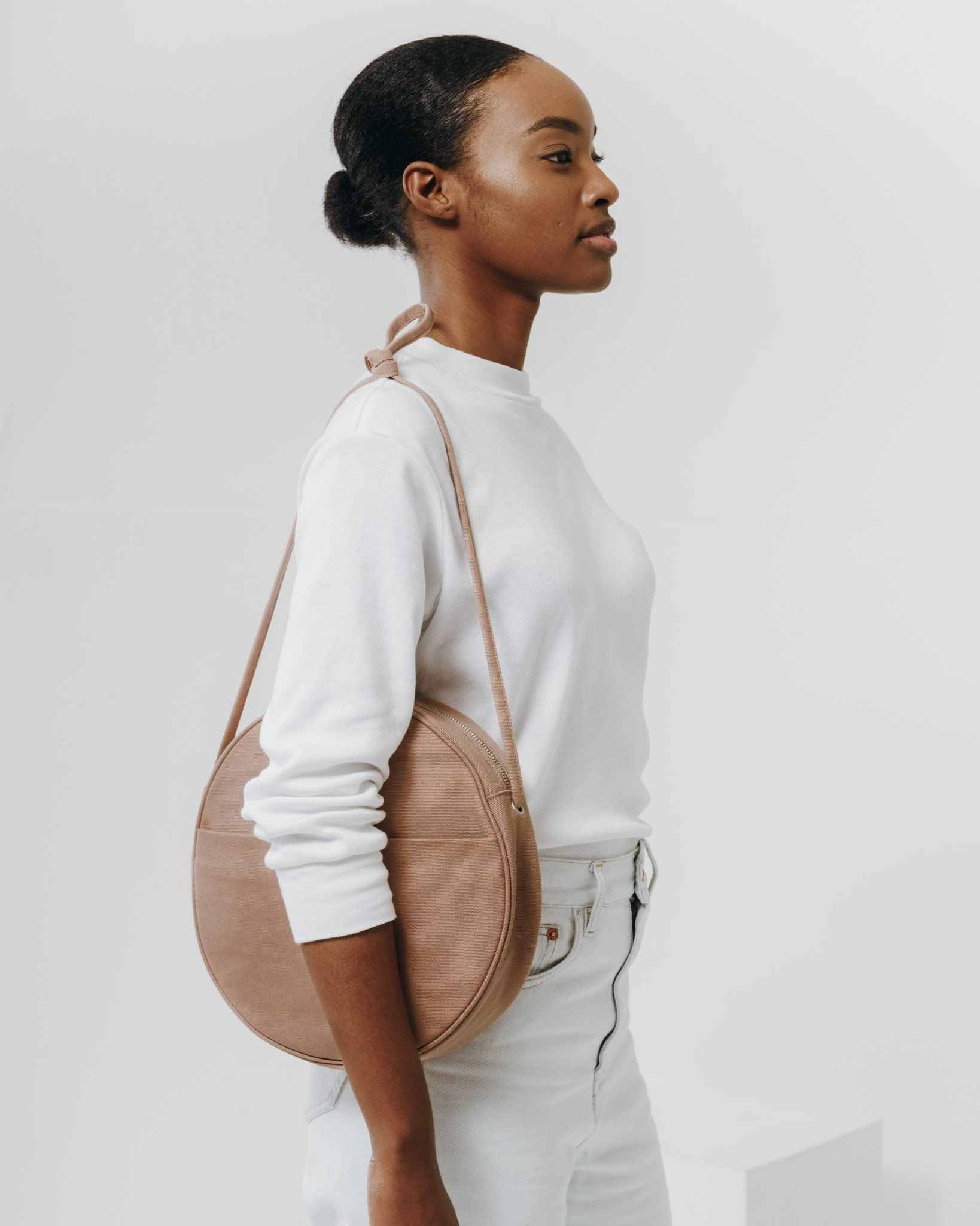 a7946cab2 An oversized circular purse in canvas. Exterior pocket for quick stashing,  and interior pocket for organization.