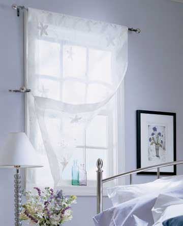 White Sheer Window Treatment Perfect To Let Light In While Retaining Privacy