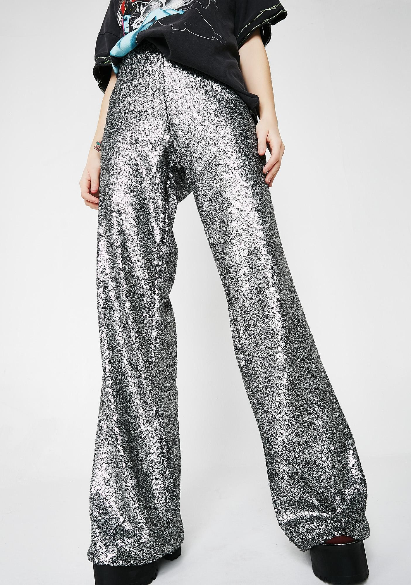 a93b69a7 Keep yourself on the dance floor with these groovy wide leg pants that have  a high waist construction and a silver sequin embellishment.