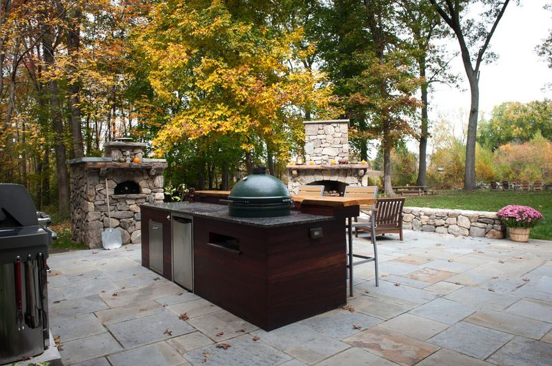 This Is An Amazing Outdoor Set Up Big Green Egg Fireplace Wet Bar Pizza Oven The Works Outdoor Rooms Patio Patio Stones
