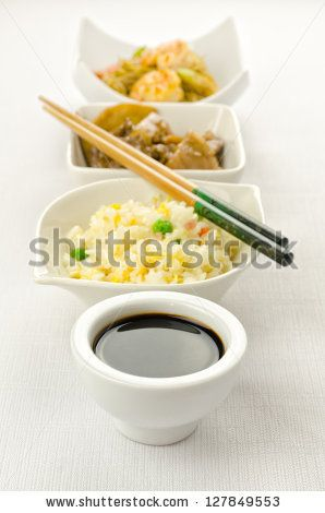 Chinese food dishes cantonese rice, noodles, beef with bamboo by MilaCroft, via ShutterStock