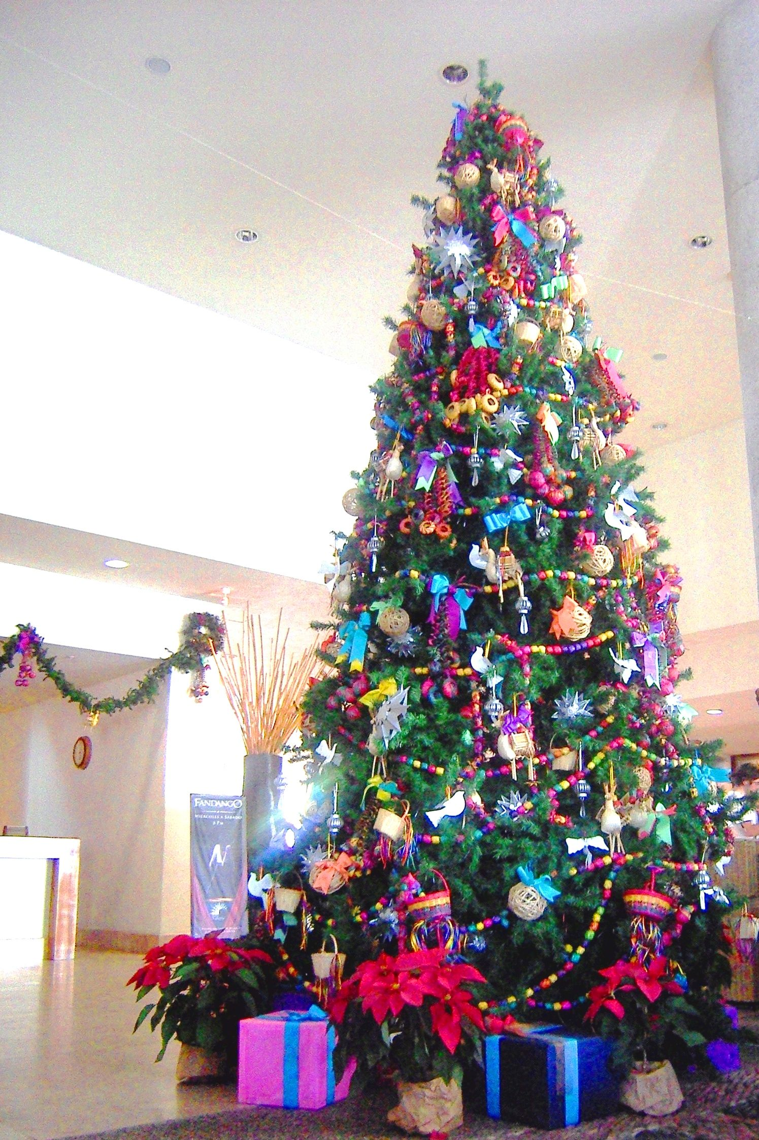 super cute christmas tree with tons of mexican decorations