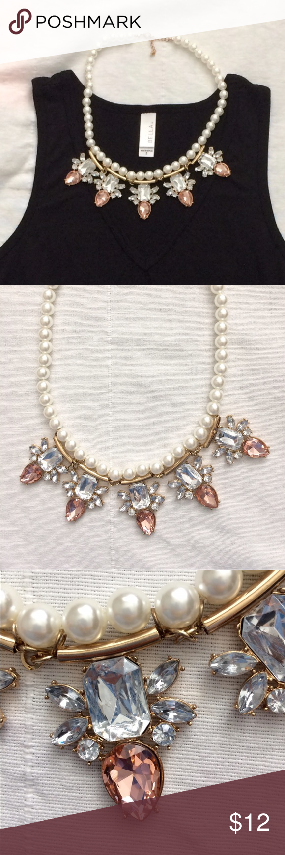 Faux Pearl Statement Necklace w/ Pink Rhinestones Statement Necklace designed with shiny floral rhinestone pendants and light pink jewels for added glamour. Faux pearls for a touch of class! Jewelry Necklaces
