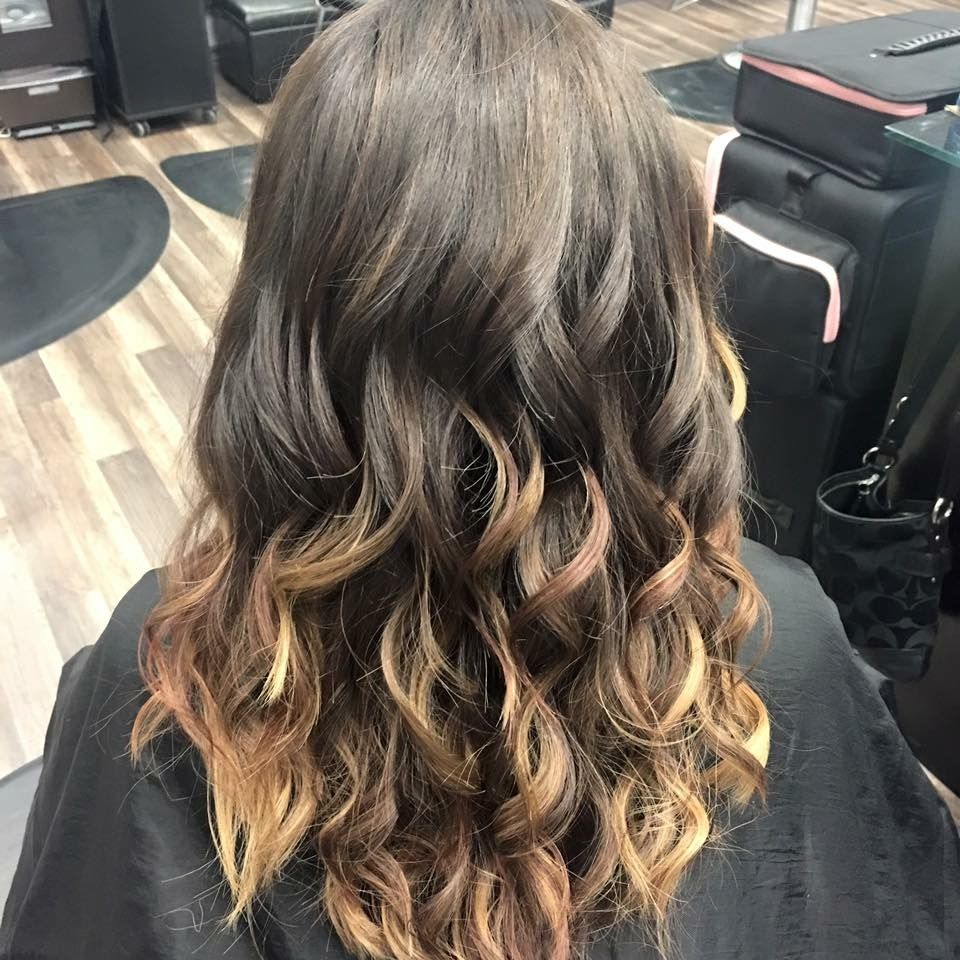 Brown to caramel ombre, trim, long hair with long layers. Flat iron curled