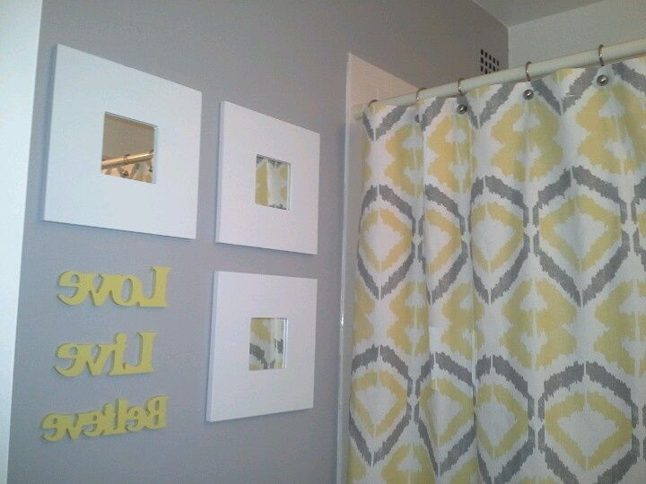 Yellow and gray bathroom wall decor