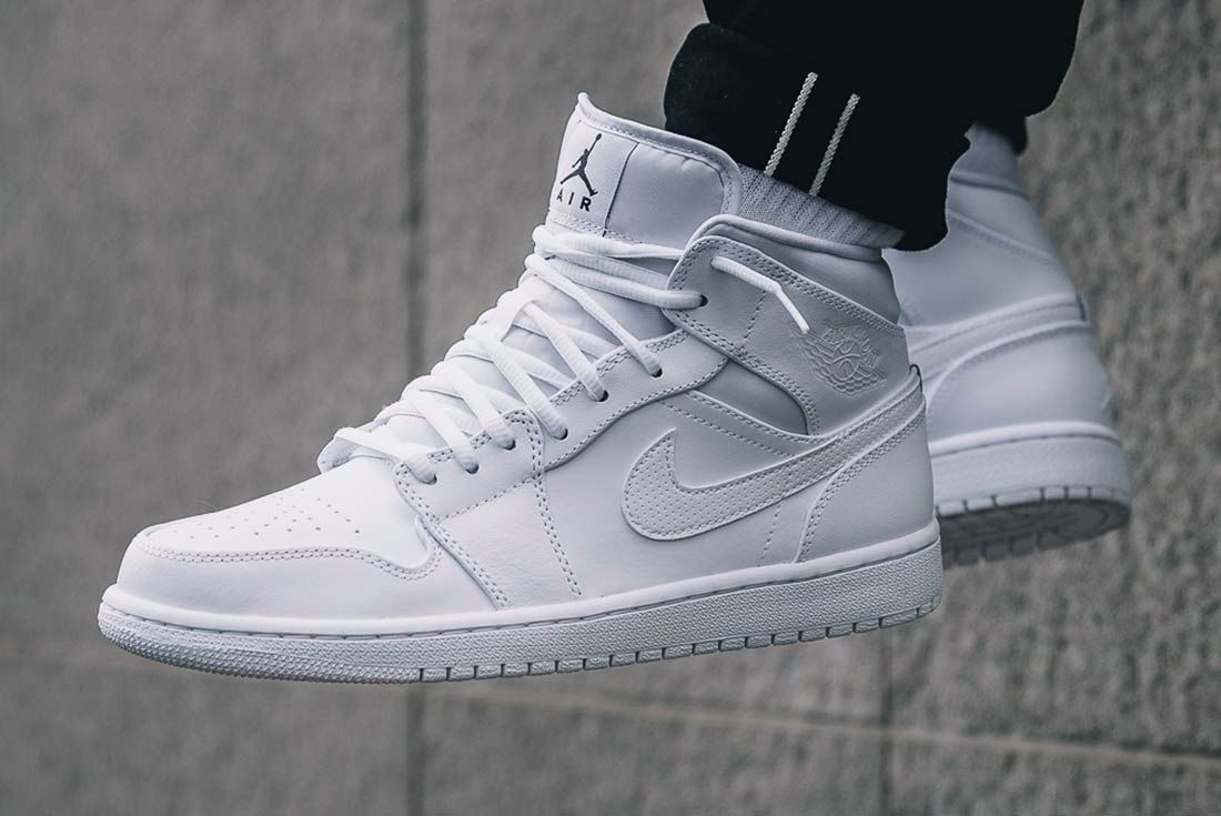 outlet store eddb6 71e5b The Air Jordan 1 Mid Goes Triple White