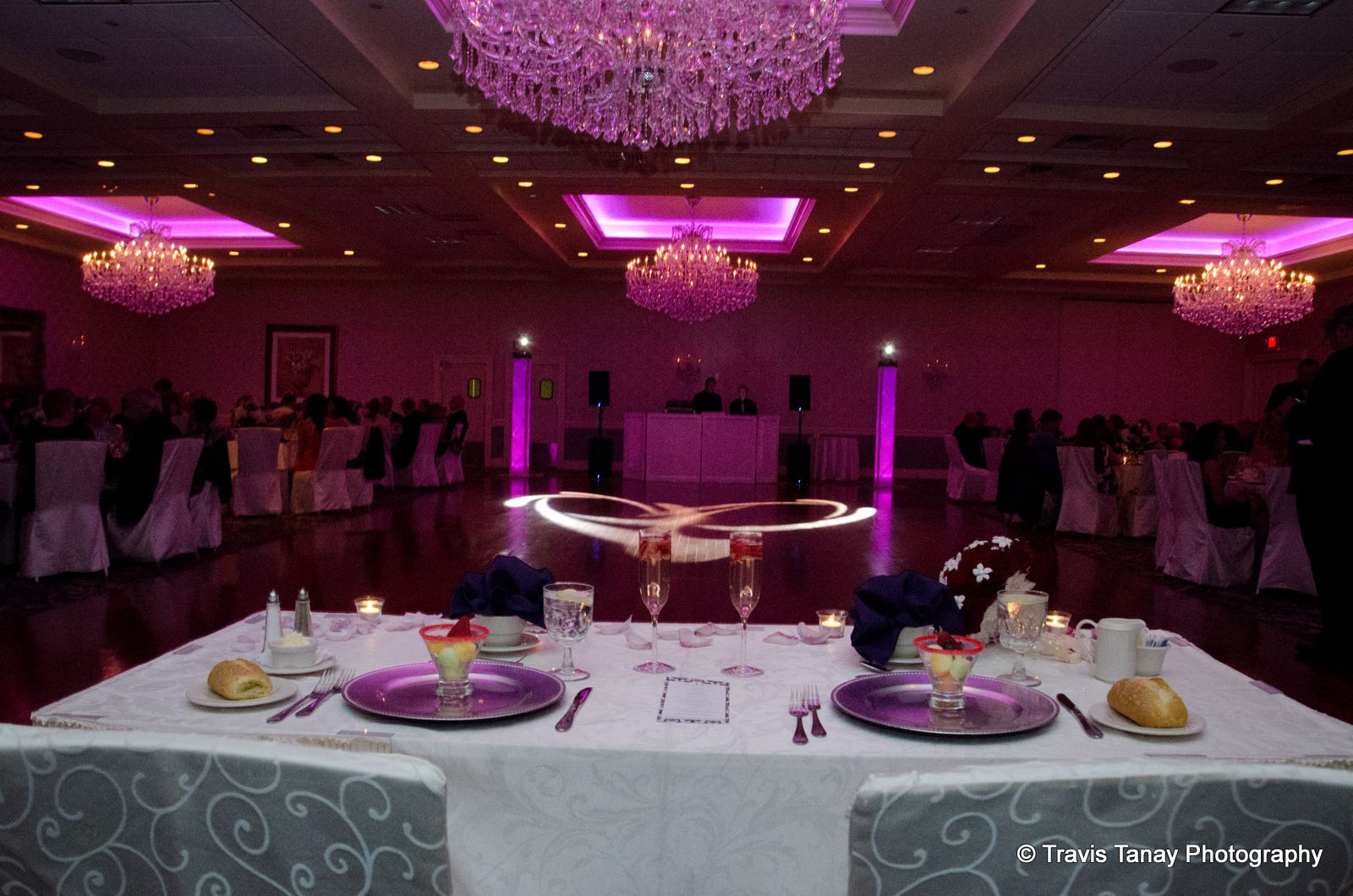 The #bride and #groom table looks over the dance floor as pink lights  illuminate the room. www.CrystalBallr… | Wedding list, Beautiful weddings, Wedding  decorations