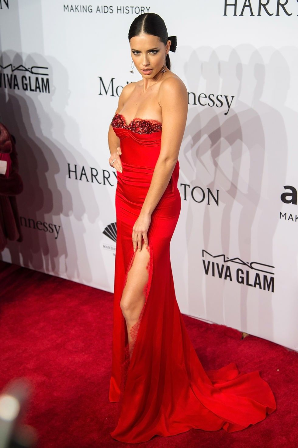Adriana lima red strapless prom dress at amfar new york gala
