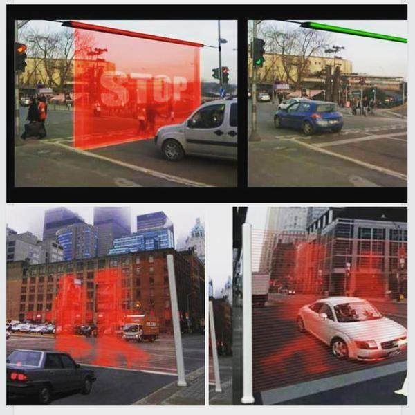 Virtual wall projects laser images when traffic light is red