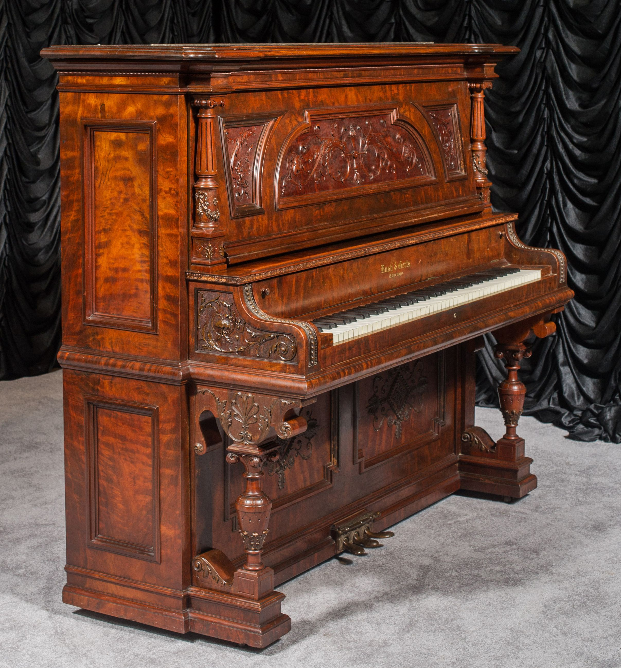 Well Loved And Used. Antiques Upright Victorian Piano With Fluting And Inlaid Decoration