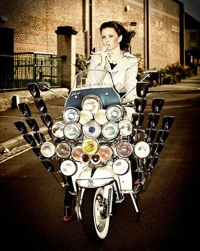 Mod Chick. I don't think she has enough mirrors on that thing!