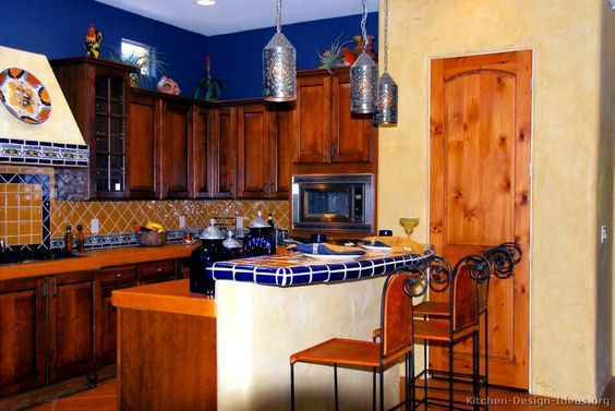 Mexican Kitchen Who Knew Orange And Blue Could Be So Decidedly Un Hojos Mexican Style Kitchens Mexican Kitchen Decor Kitchen Design Pictures