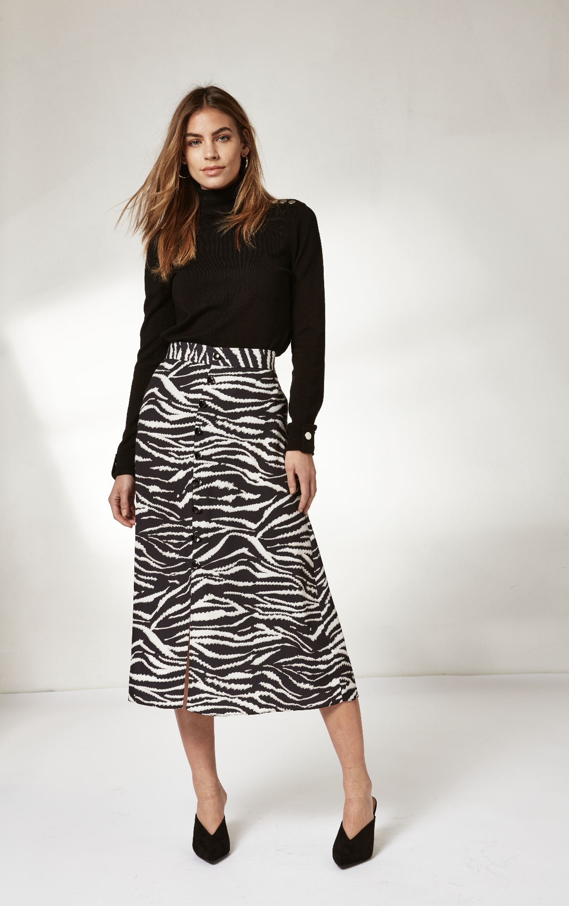 b19e57d602 A new year of style | Refresh your wardrobe for 2019 with the latest animal  print midi skirts | Wallis | Click to shop #WallisFashion #WallisLoves ...