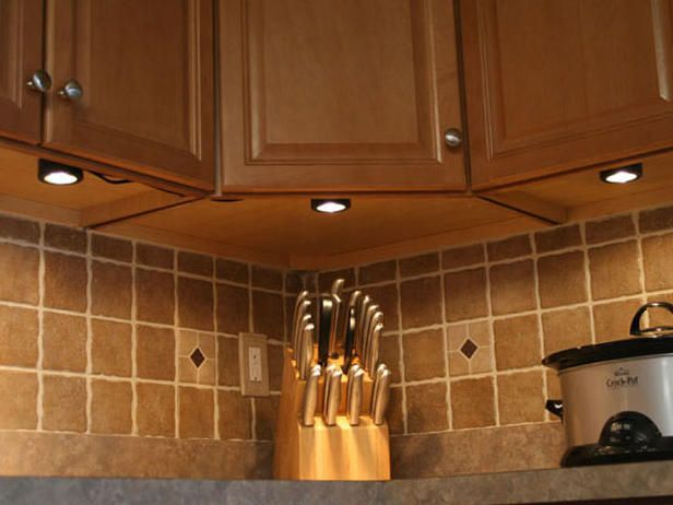 Installing under cabinet lighting cabinet lighting kitchens and 4 types of under cabinet lighting pros cons and shopping advice puck lights put out bright strong light compared to leds mozeypictures Choice Image