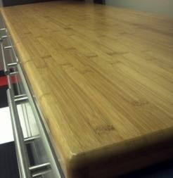 Ulti-MATE 6 ft. Bamboo Butcher Block Worktop Surface. Eco-friendly worktop surface. Made from solid bamboo. UV-cured protective coating resists moisture. No sharp corners provides added safety. Dimensions: 70.75W x 21D x 1.5H inches.