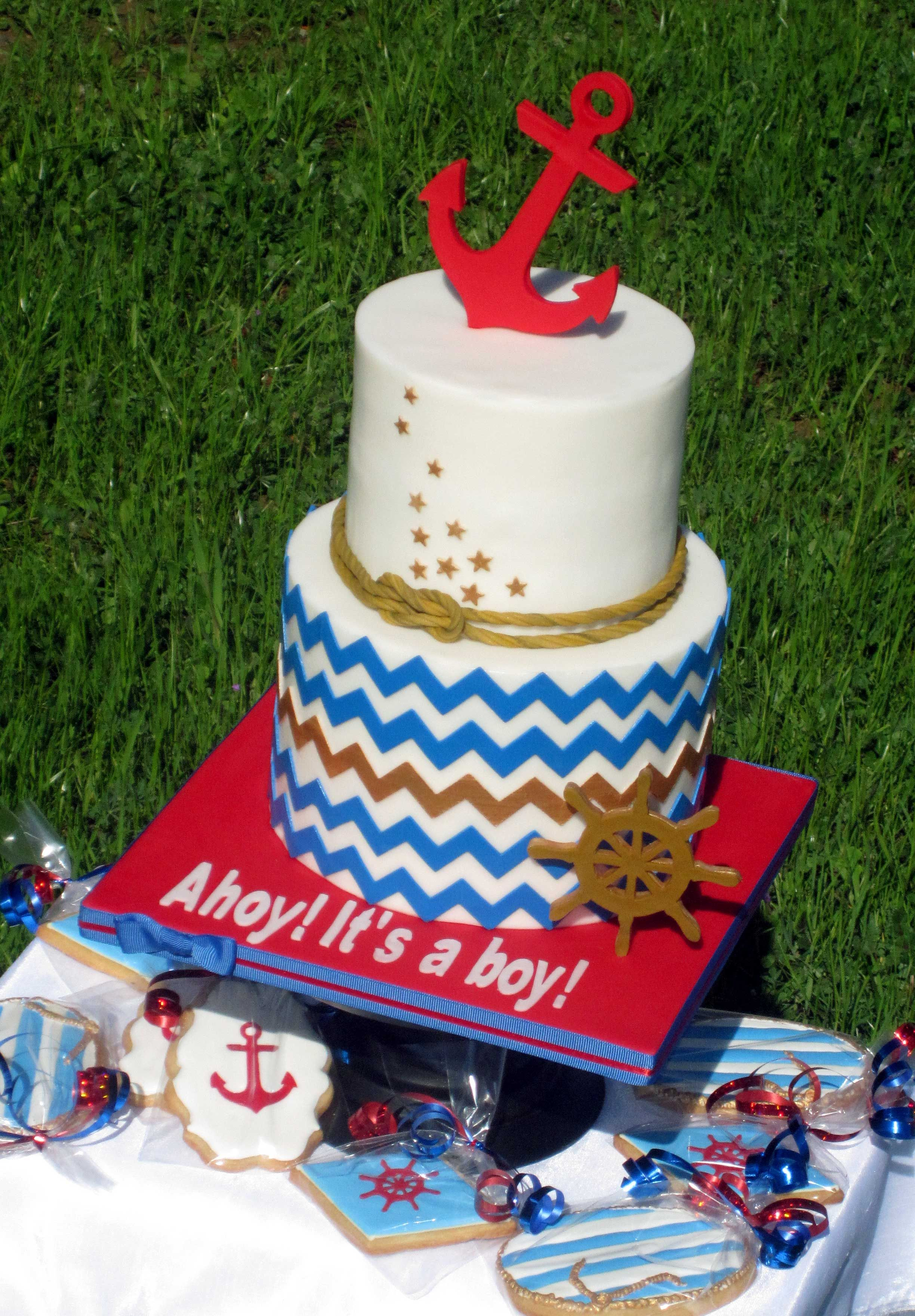 Ahoy! Its a boy! - This cake would be very difficult and time consuming if not for pattern cutting machine. I use Cricut Cake and it makes all pattern cuttings with an ease and total precision. The anchor, the wheel, the chevron patterns, letters and stars, all cut using it! Cookies, however, were all hand piped, with nothing else but sugar and love !