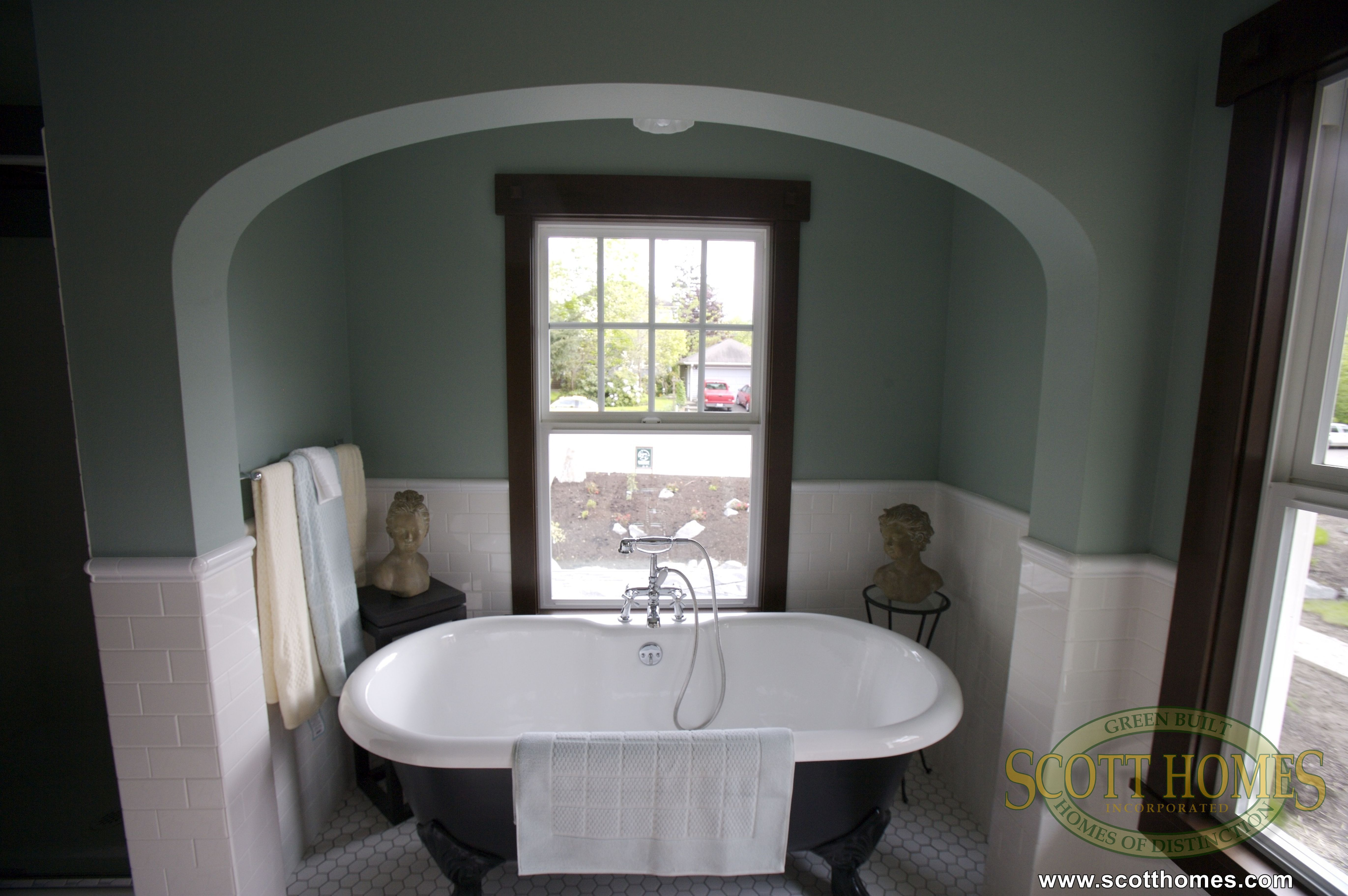 The old fashioned bathtub in the alcove is warm and inviting ...
