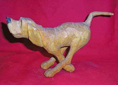 Images of Dogs carved by Ted