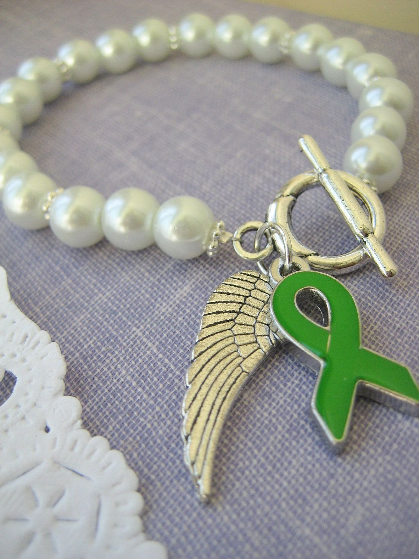 Green awareness ribbon charm angel wing white glass pearl bracelet.