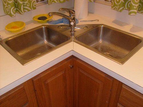 kitchen corner sinks oil rubbed bronze sink cabinet design ideas