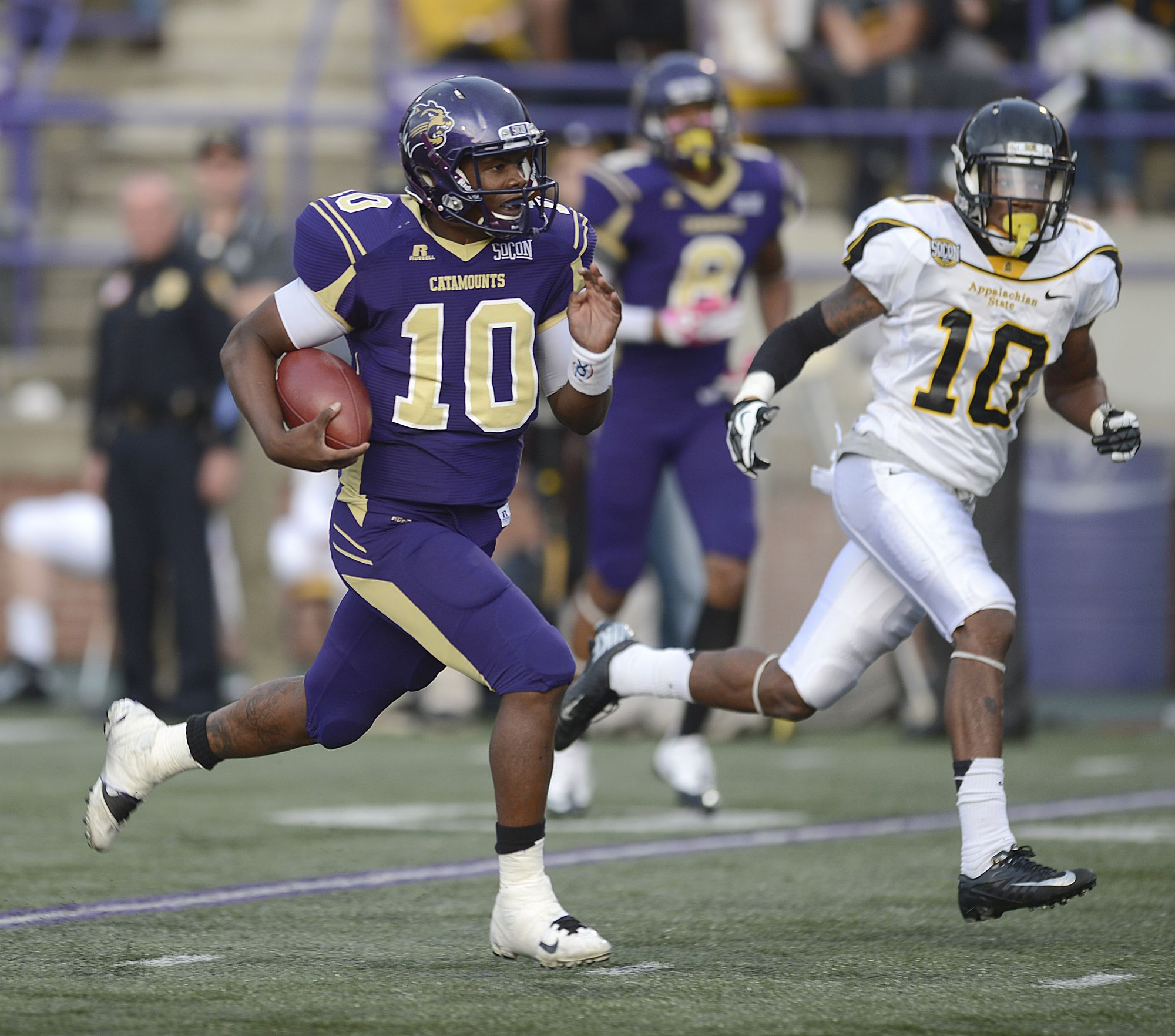 Catamount quarterback Troy Mitchell rushing for one of his