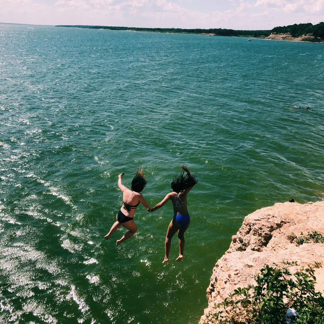 Girls Jumping Off A Cliff At Rockledge Park In Grapevine Texas Cliff Diving Water Adventure Local Hiking Trails