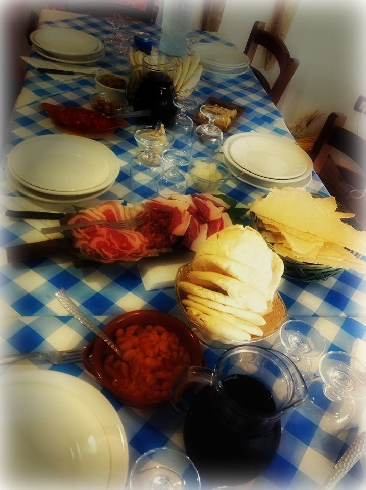 "Here a set table with: the very strong Barbagia's wine (in the center of Sardinia -Barbagia- we have the strongest wines, because we had to defend ourselves from cold); the typical Sardinian bread ""pane carasau"" (on the right) and the Desulo's bread (in the center); our amazing raw ham and other local cold cuts! Hungry?"