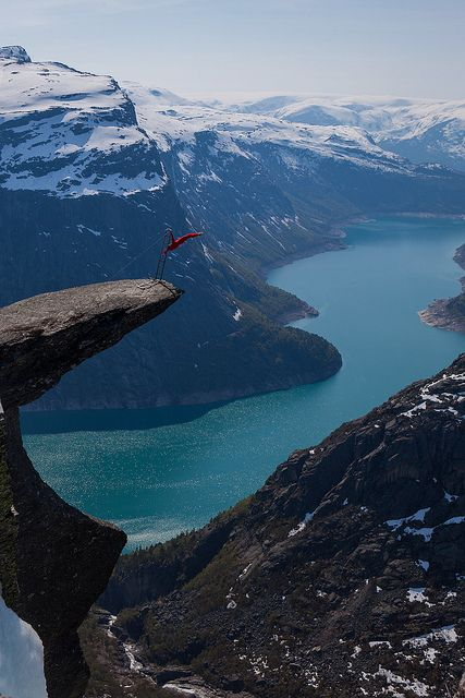 Balancing on the tongue - Eskil Rønningsbakken, a norwegian extreme artist, is doing a balancing act on the tip of the Troll's Tongue (Trolltunga). There is about 300 meters to the ground under him.