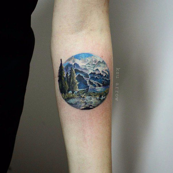 Realistic Mountains View With Trees In Circle Tattoo On