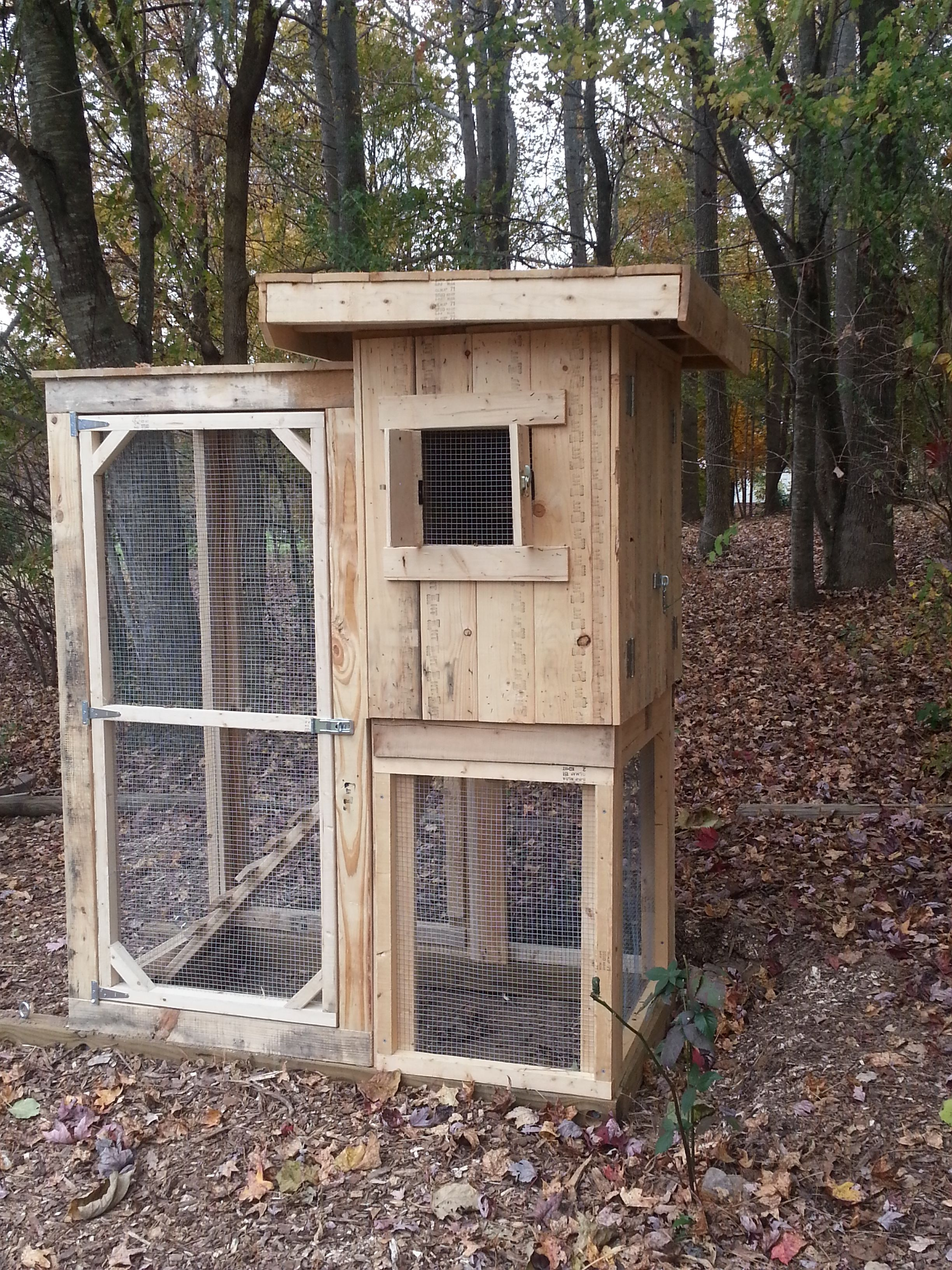 Small chicken coop that is tall enough to walk in. No ...