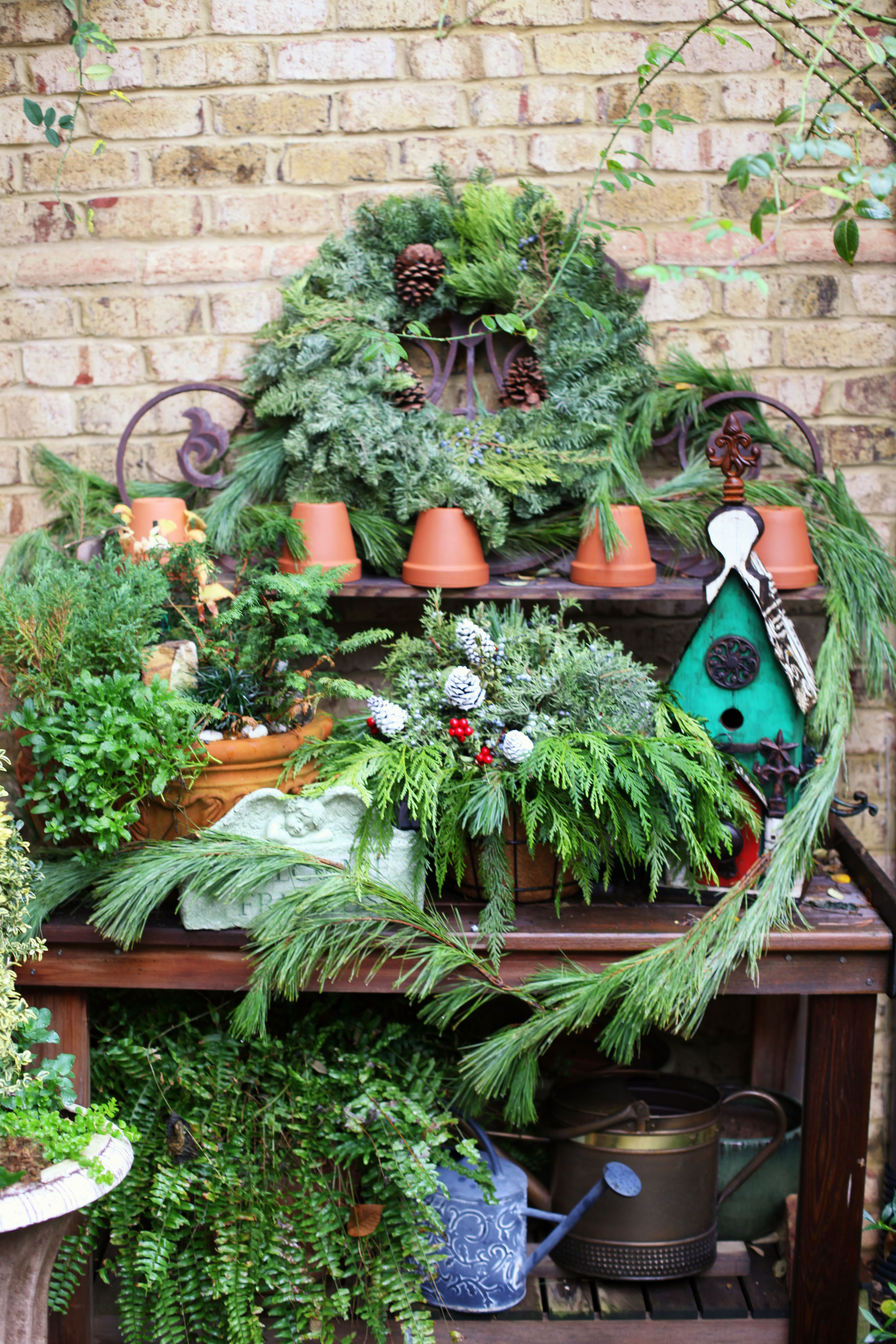 christmas evergreen potting bench christmas garden pinterest