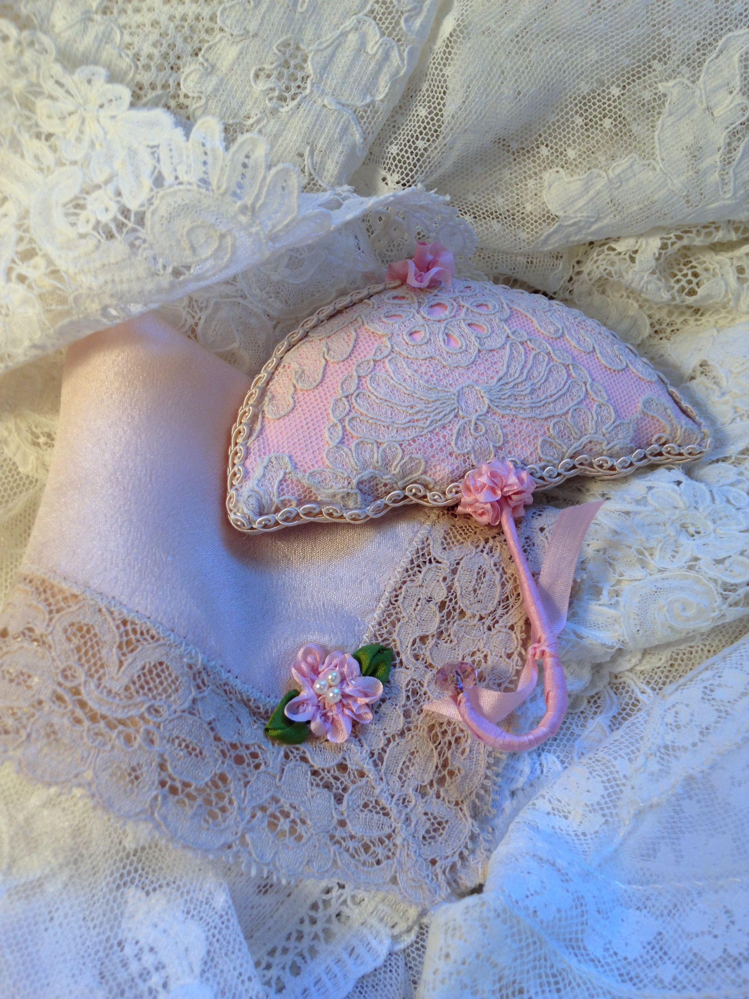 Lace handkerchief and small umbrella ornament. Silk ribbonwork added by Kathleen.