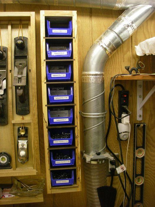 Vertical Garage Hardware Organizer With Blue Tubs Stored