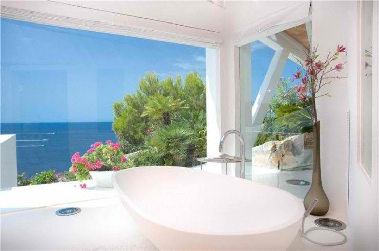 Decoholic - http://decoholic.org/2012/11/10/spectacular-villa-with-amazing-sea-view-in-majorca-spain/