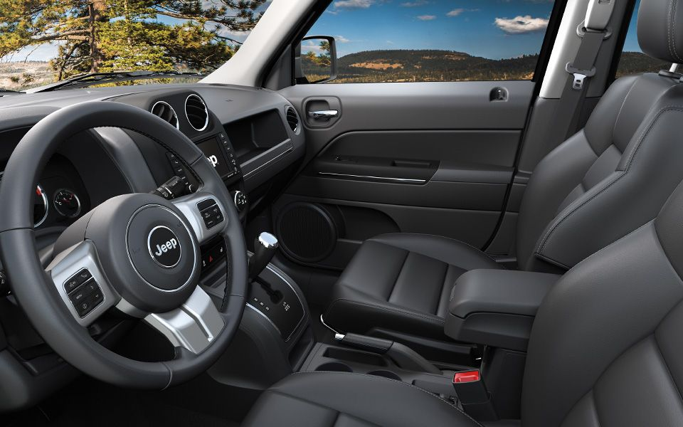 Jeep Patriot Features A Spacious Interior With Soft Touch Materials For Added Comfort Limited Model Shown With M Jeep Patriot Jeep Patriot Interior 2015 Jeep