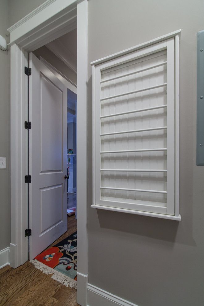 Marvelous Wall Mounted Clothes Drying Rack In Laundry Room Traditional With Cool Coat Hooks Next To