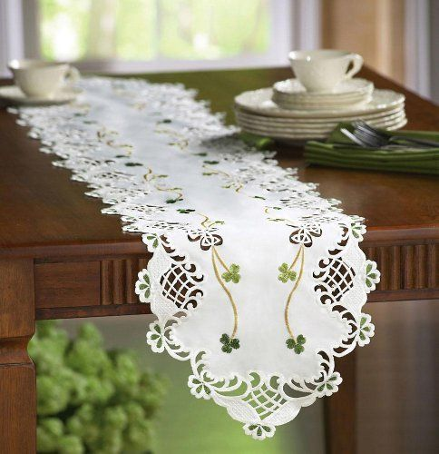 """Irish Shamrock Table Runner W/ Embroidered Accents By Collections Etc by Collections. $9.99. Openwork flourishes edge the entire length. Lacy runner makes any table setting truly special. Pretty shamrock embroidery giving the center a lyrical Irish accent. Measures 70""""L x 13""""W. Conveys the look of a real treasured heirloom. With the look of a real treasured heirloom, this lacy runner makes any table setting truly special. Openwork flourishes edge the entire length, with pretty..."""