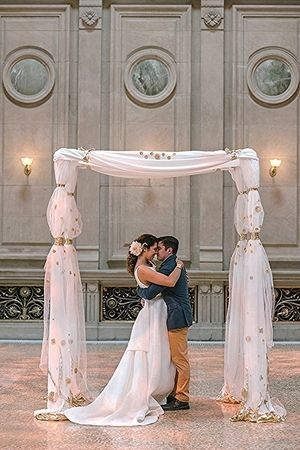 A non-floral custom chuppah made from crepe, tulle and lots of original gold detailing for Weylin B. Seymours. Get a glimpse inside our custom design process at our website. Photo by KM Photography NYC