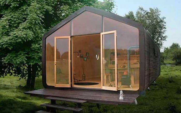 Cette maison est 100 recyclable  elle est en carton ! Une - maison bois et paille