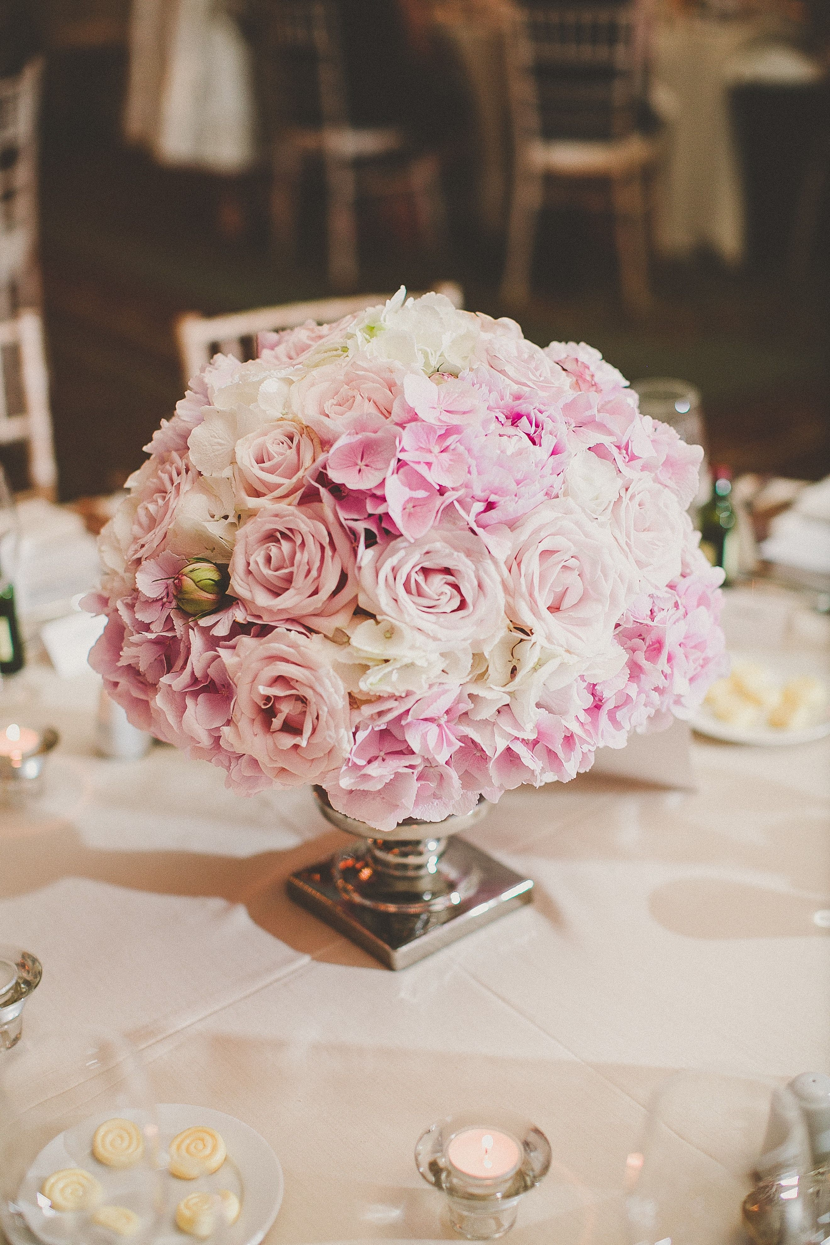 Blush pinks white low table centrepiece pink
