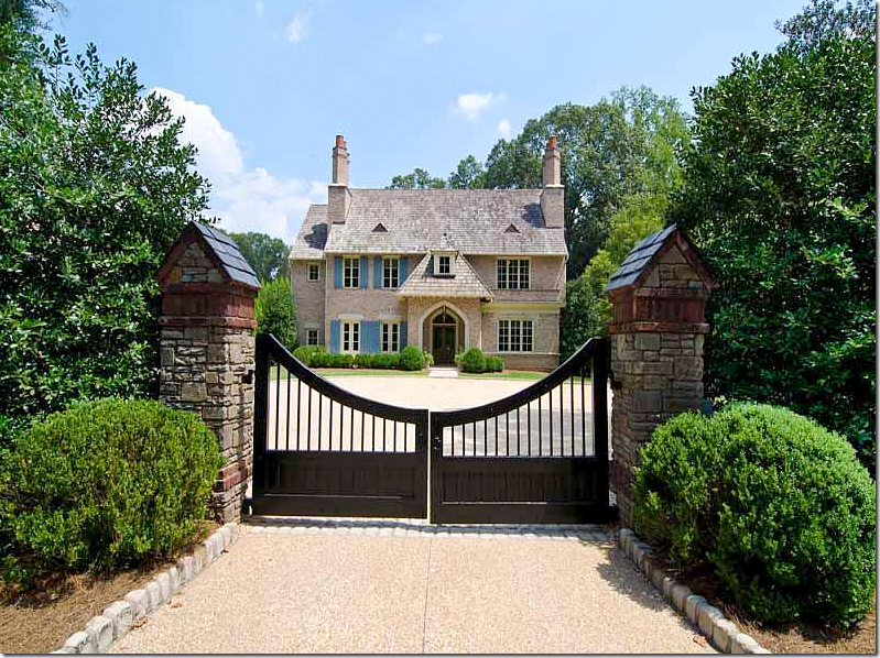 Pretty Gated Entry And Normandy Style Design Exterior