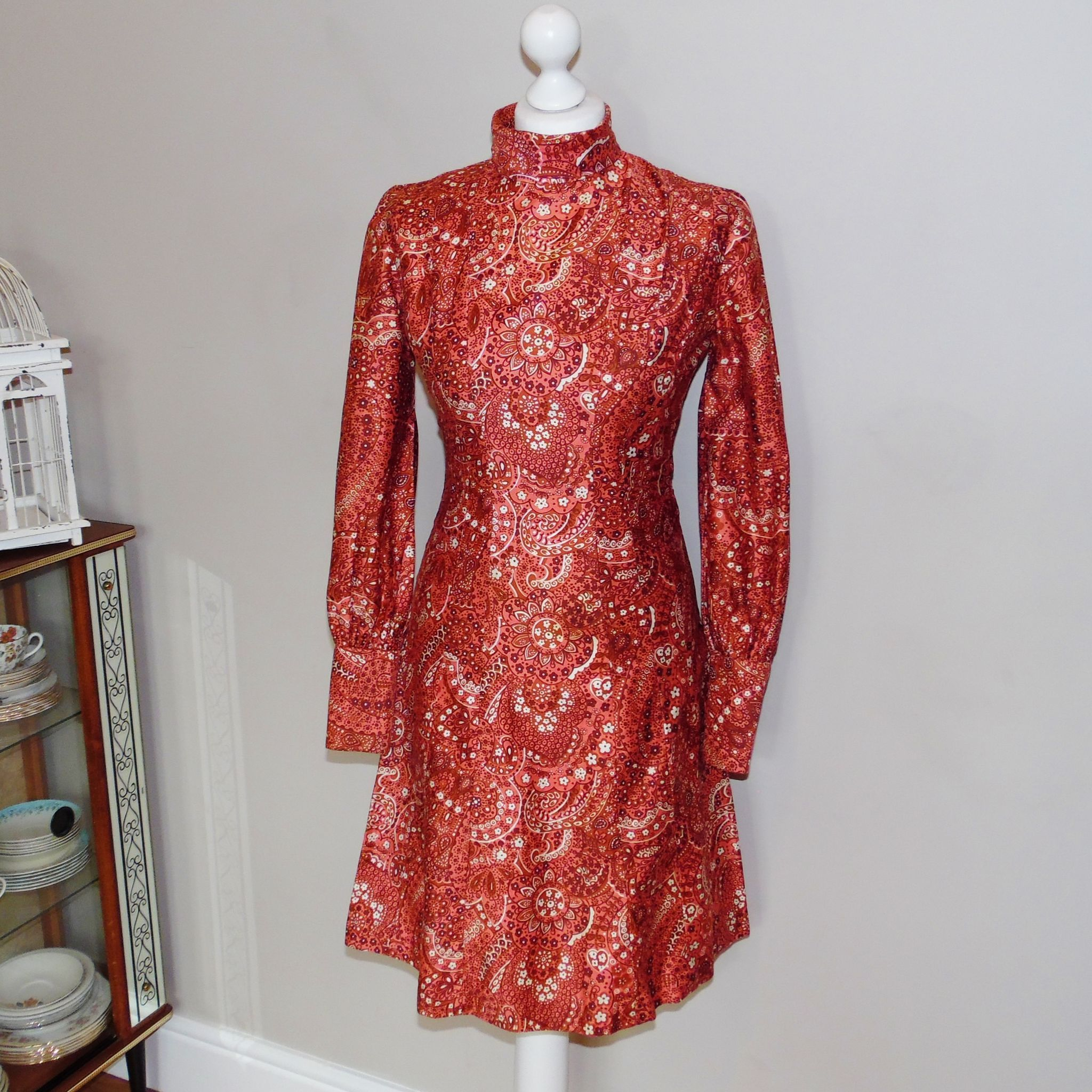 Long sleeve dress with red and coral psychedelic floral print has a