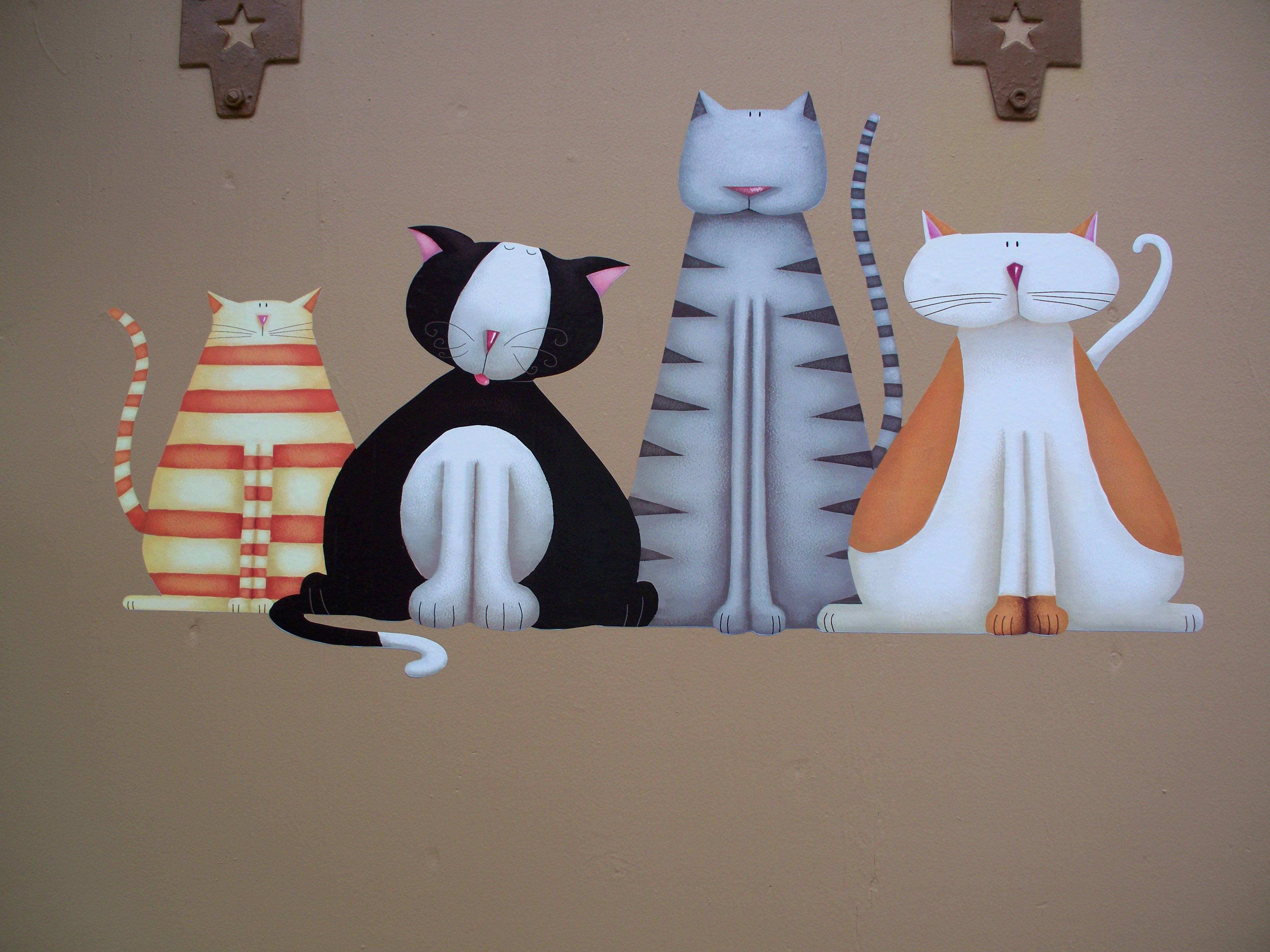 this is a wall decal. hobby lobby has a nice selection. this is on the door to the cat room in the bunkhouse.