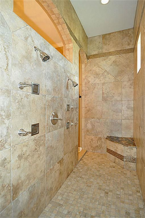 Wonderful walk-through shower has block glass with dual shower ...